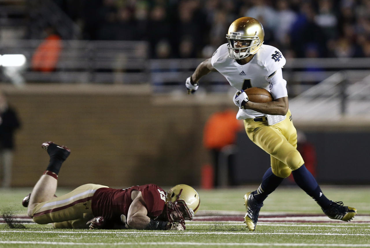 Notre Dame running back George Atkinson III runs past Boston College linebacker Tim Joy during the first half of an NCAA college football game in Boston on Saturday, Nov. 10, 2012. (AP Photo/Winslow Townson)