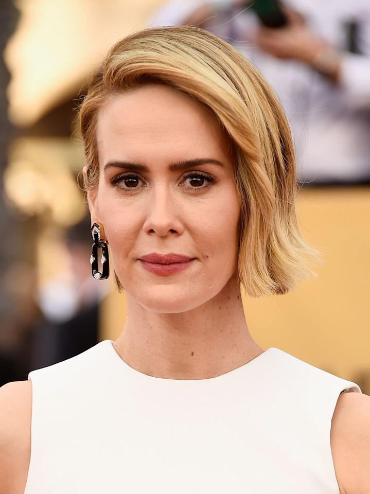 "<p>Sarah Paulson showed us this week that she can pull off essentially anything—<a href=""https://www.marieclaire.com/fashion/news/g4057/2016-emmys-red-carpet/?slide=24&thumbnails="" target=""_blank"">green sequins</a> and all—and this slicked back, asymmetrical cut is no exception. </p>"