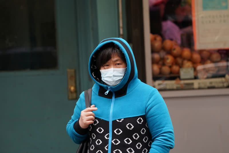Chinatown residents wear surgical masks in New York City