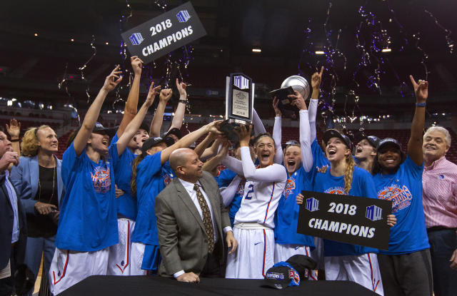 Boise State celebrates with the trophy after their 62-60 win over Nevada in an NCAA college basketball game in the championship of the Mountain West Conference tournament Friday, March 9, 2018, in Las Vegas. (AP Photo/L.E. Baskow)