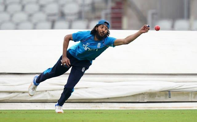 Haseeb Hameed diving for a catch during England's training session