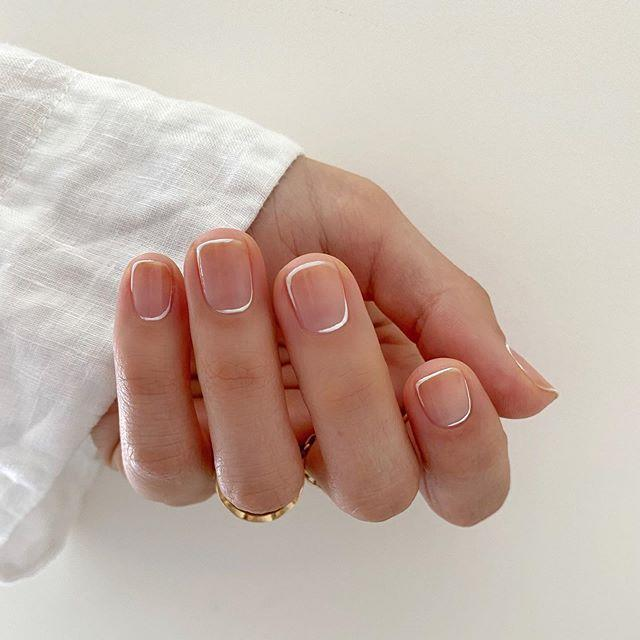 """<p>The French manicure has been undergoing a modern resurgence the last few years. If you're still cautious about adopting the trend, try this dainty and delicate version from Betina Goldstein.</p><p><a href=""""https://www.instagram.com/p/B_6IPCaDBfL/"""" rel=""""nofollow noopener"""" target=""""_blank"""" data-ylk=""""slk:See the original post on Instagram"""" class=""""link rapid-noclick-resp"""">See the original post on Instagram</a></p>"""