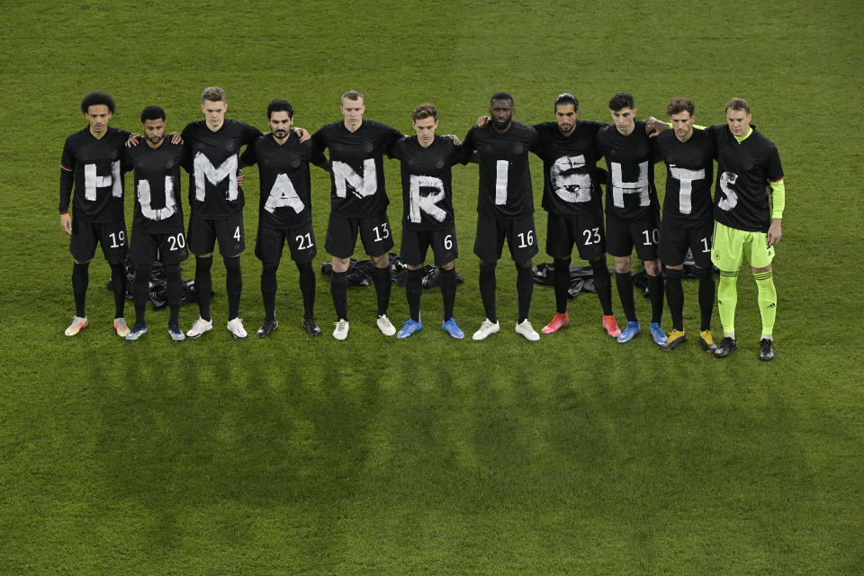 Players of Germany wear t-shirts which spell out