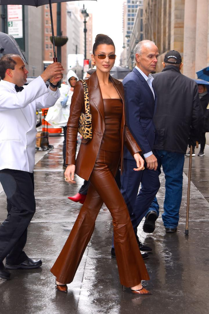 For <em>Variety</em>'s Power of Women event, Bella Hadid delivered one of her finest sartorial tributes to the '90s of all time in a chestnut-hued Rosetta Getty all-leather get-up. We're talking a Rachel Green-worthy jacket, matching flares and a pair of vinyl shoes to finish. Oh, and the animal print baguette bag and tinted micro sunnies gave the ensemble one last touch of nostalgia. <em>[Photo: Getty]</em>