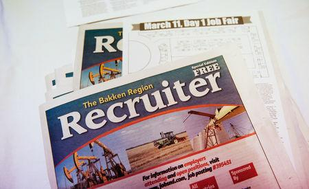 A pamphlet describing job opportunities is pictured at a job fair in Williston, North Dakota