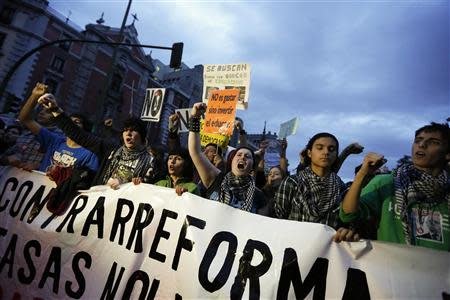 Protesters take part in a demonstration on the third day of a nationwide student strike against rising fees and educational cuts in Madrid