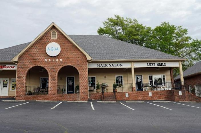 The Aqua Salon in Tucker, Georgia is another business that would soon reopen under Governor Brian Kemp's controversial plan (AFP Photo/Tami Chappell)