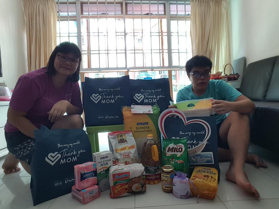 Chan Kam Ling (left), mother of athletics and swimming Special Olympics athlete Jeremy Yeo, with the P&G care packs. (PHOTO: Proctor & Gamble)
