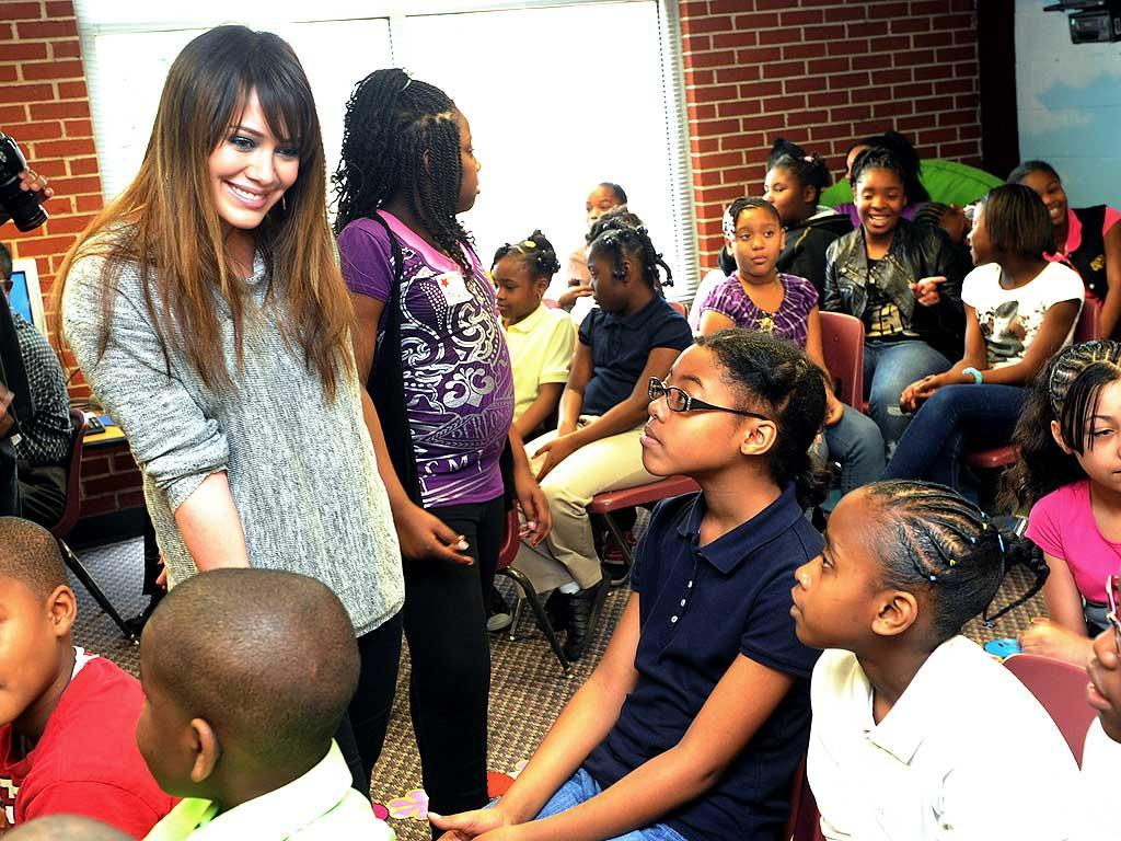 "Hilary Duff took time out to do a little good by supporting the ""Blessings in a Backpack"" program and handing out backpacks filled with food at an elementary school in Atlanta, Georgia, on Monday. The singer then proudly presented a check for more than $44,000 to the school, which will help feed 330 kids for two years. Rick Diamond/<a href=""http://www.gettyimages.com/"" target=""new"">GettyImages.com</a> - March 21, 2011"