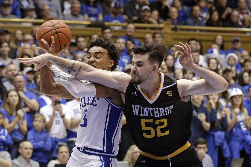 "FILE - In this Friday, Nov. 29, 2019 file photo, Duke guard Tre Jones (3) and Winthrop guard Chandler Vaudrin (52) reach for the ball during the second half of an NCAA college basketball game in Durham, N.C. Winthrop coach Pat Kelsey says he learned his philosophy of basketball while playing for the late Skip Prosser at Xavier in the 1990s. ""He had a famous quote that he said all the time,"" Kelsey recalled. ""The older he got, the faster he wanted to play. I think that applies to me."" (AP Photo/Gerry Broome, File)"