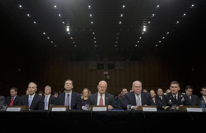 Director of National Intelligence James Clapper, center, and other security agency officials, testify on Capitol Hill in Washington, Wednesday, Jan. 29, 2014, before the Senate Intelligence Committe hearing on current and projected national security threats against the US. From left are, National Counterterrorism Center Director Matthew Olsen, FBI Director James Comey, CIA Director John Brennan, and Defense Intelligence Agency Director Lt. Gen. Michael Flynn. (AP Photo/Pablo Martinez Monsivais)