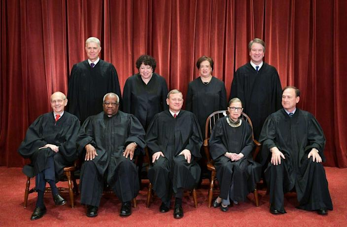 Justices of the US Supreme Court pose for their official photo at the Supreme Court in Washington, DC on November 30, 2018. (Photo by MANDEL NGAN/AFP via Getty Images)