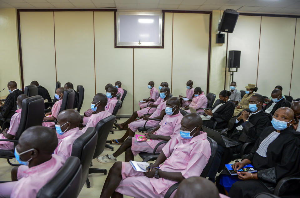 """Other defendants and lawyers sit in the courtroom in the case of Paul Rusesabagina, who boycotted the announcement of the verdict, at a court in Kigali, Rwanda Monday, Sept. 20, 2021. The man who inspired the film """"Hotel Rwanda"""" has been convicted of terrorism offenses and sentenced to 25 years in prison in a trial that human rights watchdogs and other critics of Rwanda's repressive government have described as an act of retaliation. (AP Photo/Muhizi Olivier)"""
