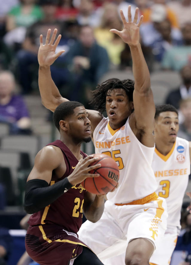 Loyola-Chicago forward Aundre Jackson looks before passing the ball as Tennessee forward Yves Pons (35) defends during the first half of a second-round game at the NCAA men's college basketball tournament in Dallas, Saturday, March 17, 2018. (AP Photo/Tony Gutierrez)