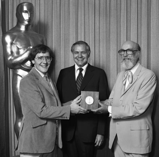 """This undated publicity photo provided by the Motion Picture Academy of Arts and Sciences shows from left, John Lasseter, winner, Animation Achievement Award """"Lady and the Lamp,"""" at the 1979 (6th) Student Academy Awards ceremony, Don Honicky, head of college relations for the Bell System, and presenter film animator T. Hee in Beverly Hills, Calif. (AP Photos/AMPAS, Long Photography)"""