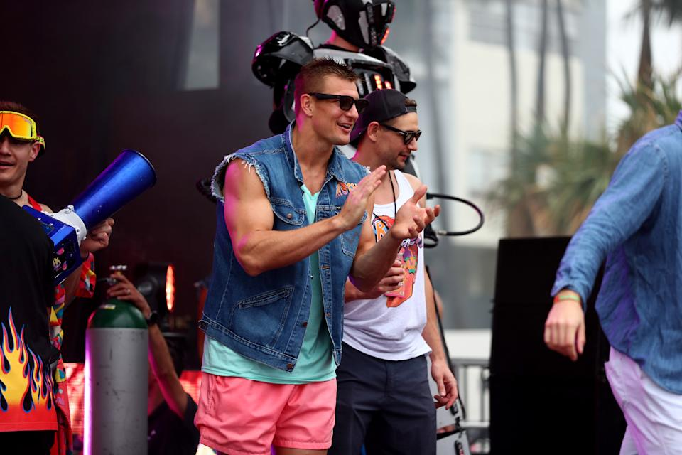 """Rob Gronkowski is seen on stage during """"Gronk Beach"""" at North Beach Bandshell & Beach Bowl on February 01, 2020 in Miami, Florida. (Photo by Joe Scarnici/Getty Images for Wrangler)"""