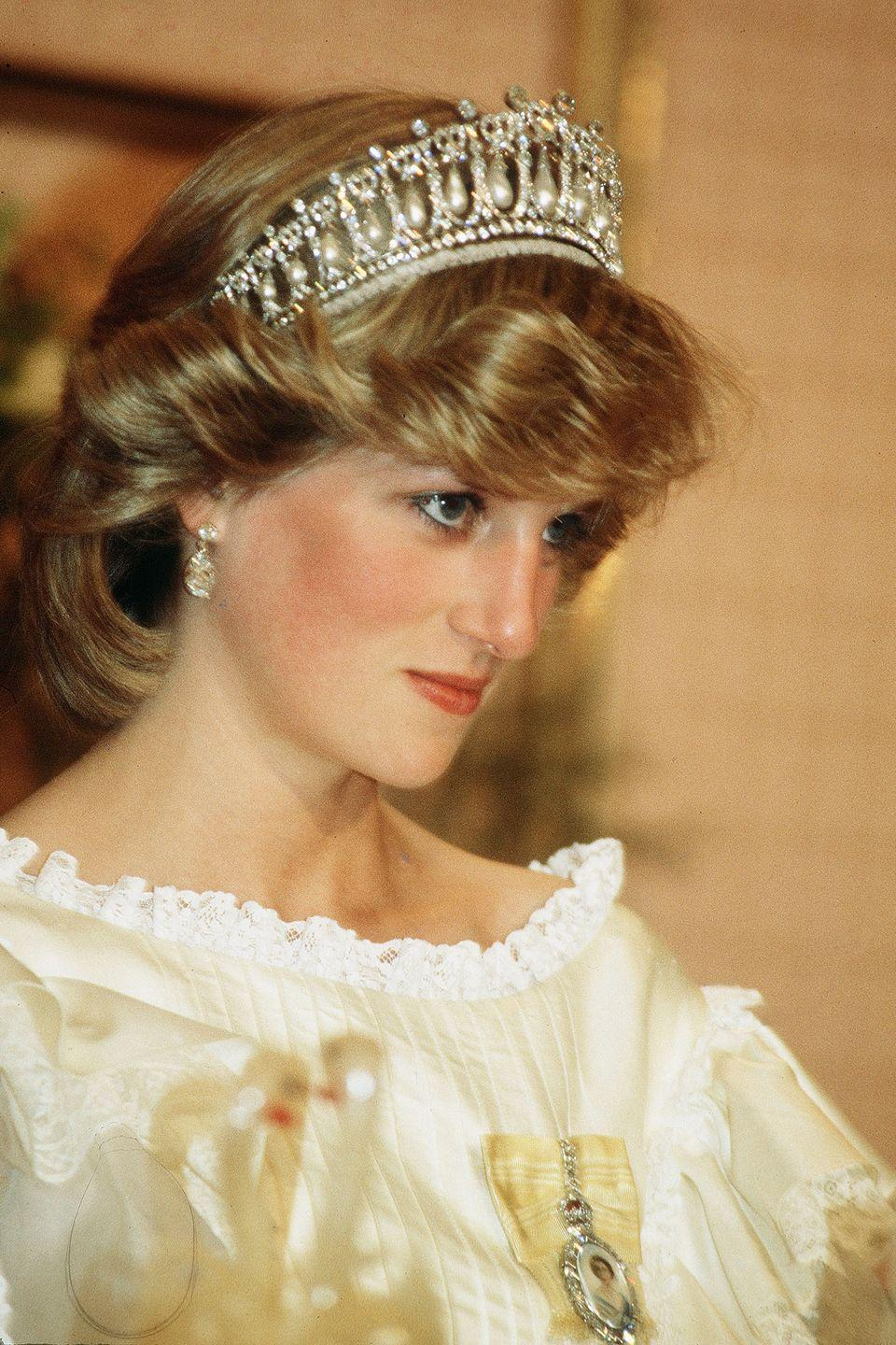 <p>Also known as Queen Mary's Lover's Knot tiara, this diamond and pearl headpiece was commissioned by Queen Mary in 1913 when she had asked British jeweler Garrard to replicate a tiara owned by her grandmother, Princess Augusta of Hesse-Kassel. It was inherited by the Queen, who gave it to Princess Diana when she married Prince Charles, but it was returned to the Queen after the couple divorced in 1996. Today it is owned by the Queen and remains a favorite with the Duchess of Cambridge, who borrows it for special occasions.</p>