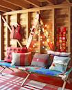 """<p>Skis wrapped in Christmas lights instantly up the coziness factor in the basement of <a href=""""https://www.countryliving.com/home-design/house-tours/g3857/christmas-camp-decorating-ideas/"""" rel=""""nofollow noopener"""" target=""""_blank"""" data-ylk=""""slk:this California cabin"""" class=""""link rapid-noclick-resp"""">this California cabin</a>.</p><p><a class=""""link rapid-noclick-resp"""" href=""""https://www.amazon.com/s/ref=nb_sb_noss_2?url=search-alias%3Dgarden&field-keywords=vintage+christmas+lights&rh=n%3A1055398%2Ck%3Avintage+christmas+lights&tag=syn-yahoo-20&ascsubtag=%5Bartid%7C10050.g.1247%5Bsrc%7Cyahoo-us"""" rel=""""nofollow noopener"""" target=""""_blank"""" data-ylk=""""slk:SHOP CHRISTMAS LIGHTS"""">SHOP CHRISTMAS LIGHTS</a><br></p>"""