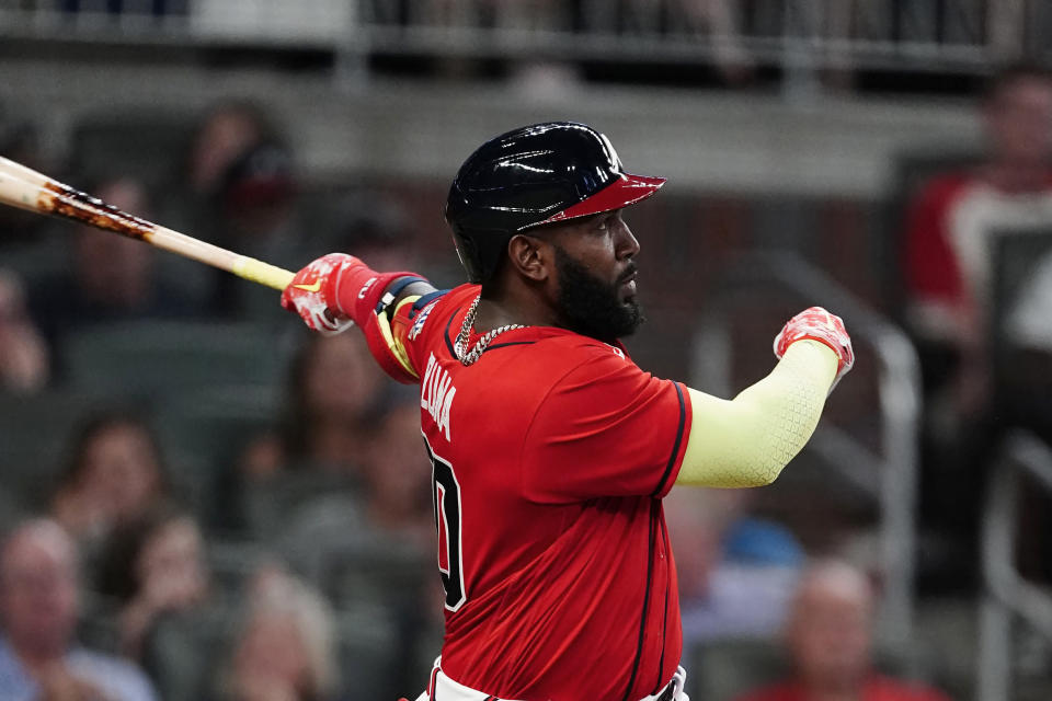 Atlanta Braves' Marcell Ozuna (20) follows through on a solo home run during the sixth inning of the team's baseball game against the Pittsburgh Pirates on Friday, May 21, 2021, in Atlanta. (AP Photo/John Bazemore)