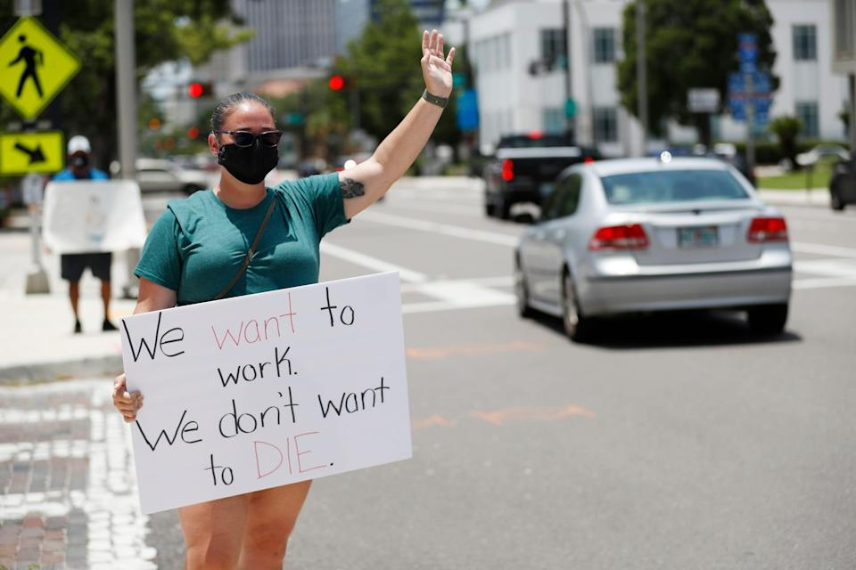 Middle school teacher Danielle Weigand stands in protest in front of the Hillsborough County Schools District Office on July 16, 2020, in Tampa, Fla. Teachers and administrators from Hillsborough County Schools rallied against the reopening of schools due to health and safety concerns amid the COVID-19 pandemic.