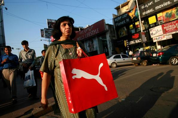 BANGALORE, INDIA - APRIL 14: (ISRAEL OUT) A woman walks the street, on April  14, 2008 in Bangalore, India. Many residents work for multi-national cooperations and the economy is booming. New construction for offices is under way. Shopping malls open frequently and the shops are full of western merchandise for workers with high disposable income. India's new middle class is about 300 million, and growing. (Photo by Uriel Sinai/Getty Images)