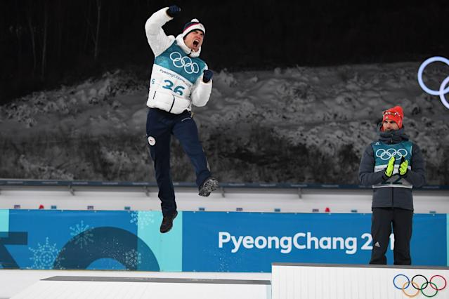 <p>Silver medallist Czech Republic's Michal Krcmar jumps in the air, as gold winner Germany's Arnd Peiffer looks on during the victory ceremony following the men's 10km sprint biathlon event during the Pyeongchang 2018 Winter Olympic Games on February 11, 2018, in Pyeongchang. / AFP PHOTO / FRANCK FIFE </p>
