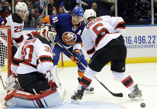 New Jersey Devils' Mark Fayne (29), goalie Martin Brodeur (30) and Andy Greene (6) guard against New York Islanders center John Tavares (91) in the second period of an NHL hockey game on Saturday Jan., 19, 2013 at Nassau Coliseum in Uniondale, N.Y. (AP Photo/Kathy Kmonicek)