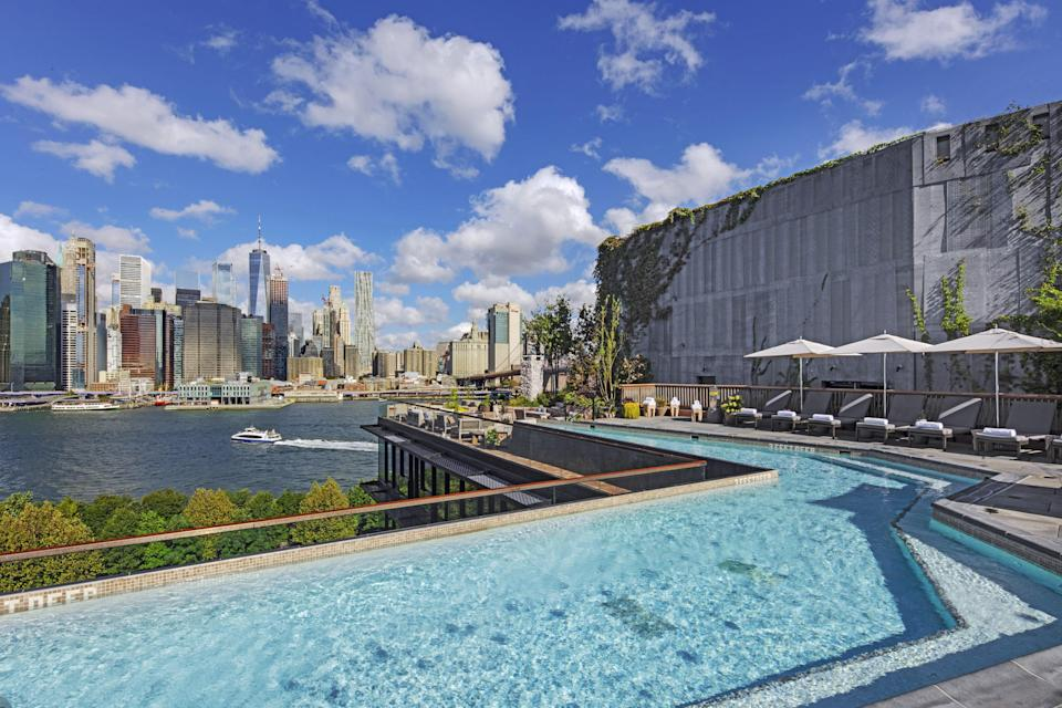 """Sure, it's more of a plunge pool than anything else, but who needs to <em>swim</em> in a rooftop pool, anyway? With views of Lower Manhattan this good (truly, the pool deck <a href=""""https://www.cntraveler.com/hotels/brooklyn/1-hotel-brooklyn-bridge?mbid=synd_yahoo_rss"""" rel=""""nofollow noopener"""" target=""""_blank"""" data-ylk=""""slk:here"""" class=""""link rapid-noclick-resp"""">here</a> is one of the best vantage points of the city), any visitor is going to be more preoccupied with posing for a good Instagram picture than actually getting their laps in. And we're okay with that."""