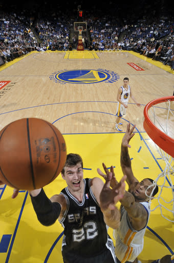 OAKLAND, CA - APRIL 16: Tiago Splitter #22 of the San Antonio Spurs lays the ball up against the Golden State Warriors on April 16, 2012 at Oracle Arena in Oakland, California. (Photo by Rocky Widner/NBAE via Getty Images)