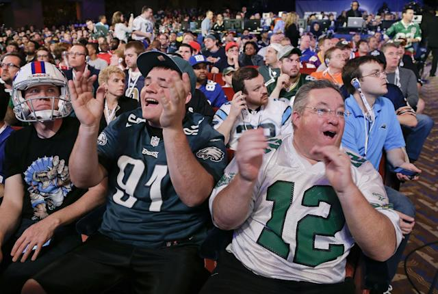 John Peniston, right, and his son, Sean, of Jamison, Pa., react to the announcement of the Philadelphia Eagles fourth-round selection at the 2014 NFL Draft, Saturday, May 10, 2014, in New York. The Eagles chose Florida cornerback Jaylen Watkins. (AP Photo/Julie Jacobson)