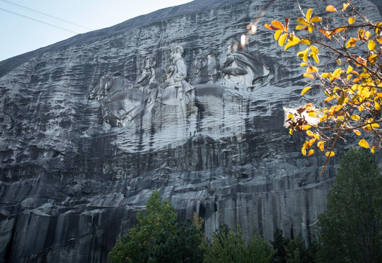 A massive carving on Stone Mountain depicts Confederate leaders Jefferson Davis, Robert E. Lee and Stonewall Jackson.