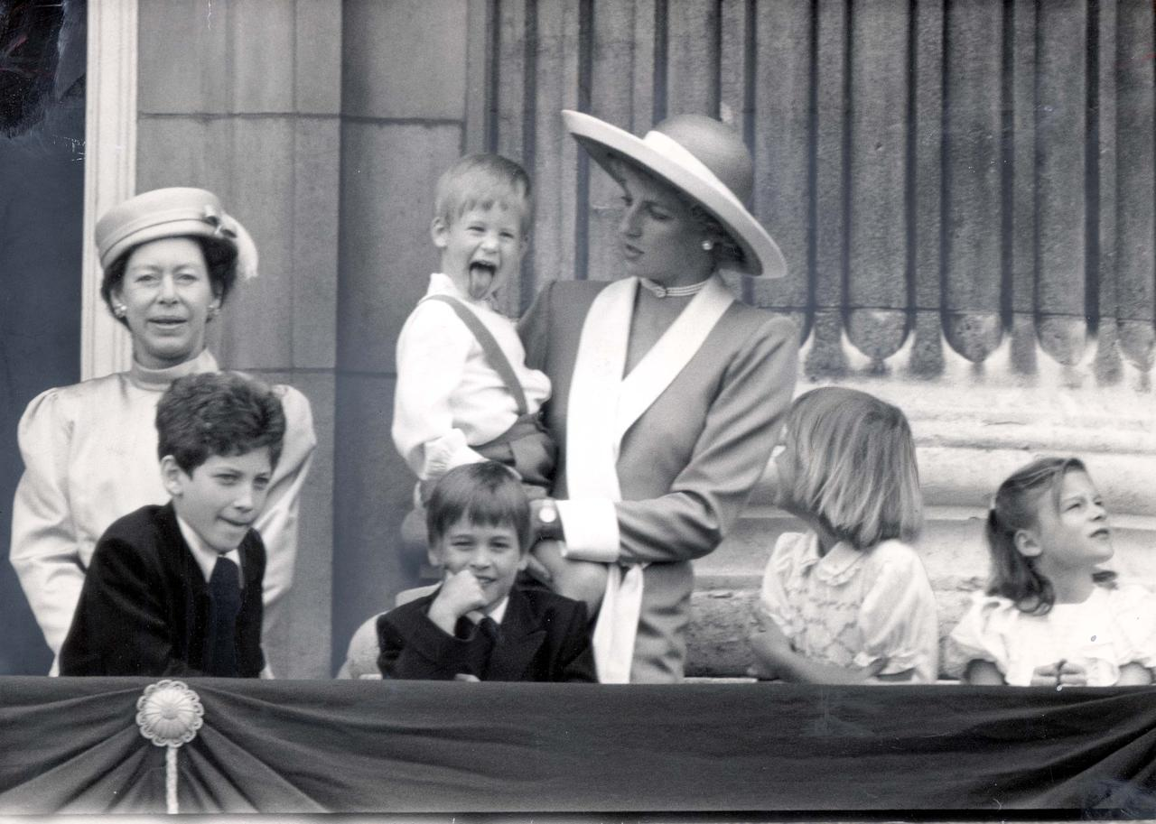 <p>During the annual parade, cheeky Harry stuck out his tongue, while being held by his mother Diana on the balcony at Buckingham Palace – stealing the limelight from the older royals (Rex) </p>
