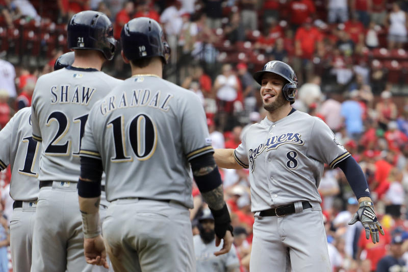 Milwaukee Brewers' Ryan Braun, right, is congratulated by teammates Travis Shaw, left, and Yasmani Grandal (10) after hitting a grand slam during the ninth inning of a baseball game against the St. Louis Cardinals Sunday, Sept. 15, 2019, in St. Louis. (AP Photo/Jeff Roberson)