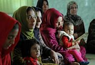 Women and girls in the Iraqi Kurdish village of Sharboty Saghira listen to a talk about the dangers of genital mutilation, on December 3, 2018