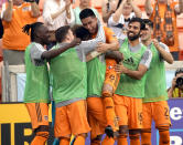 Houston Dynamo's Memo Rodriguez (8) celebrates with teammates after scoring a goal against the Montreal Impact during the first half of an MLS soccer match Saturday, March 9, 2019, in Houston. (AP Photo/David J. Phillip)