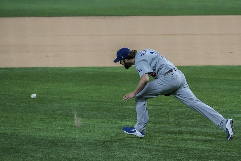 Dodgers starter Clayton Kershaw chases after a grounder hit by Atlanta's Ronald Acuna Jr.