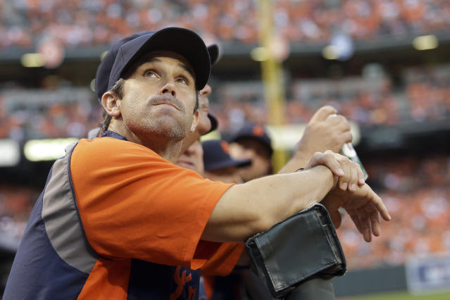 Detroit Tigers manager Brad Ausmus (7) looks up a the score board during Game 1 of baseball's AL Division Series against the Baltimore Orioles in Baltimore, Thursday, Oct. 2, 2014. (AP Photo/Patrick Semansky)