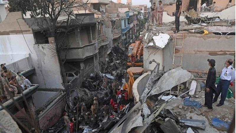 rescue workers search the wreckage