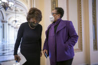 House Financial Services Committee Chairwoman Maxine Waters, D-Calif., left, and Rep. Marcia Fudge, D-Ohio, confer outside the chamber during votes, at the Capitol in Washington, Friday, Feb. 26, 2021. (AP Photo/J. Scott Applewhite)