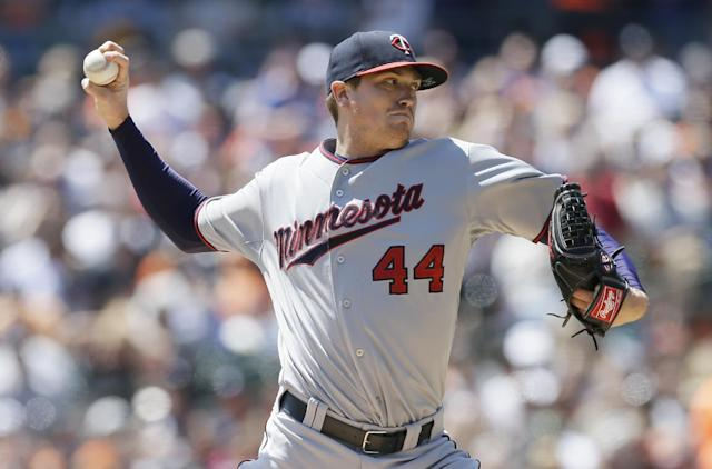 Minnesota Twins starting pitcher Kyle Gibson throws during the first inning of a baseball game against the Detroit Tigers in Detroit, Saturday, May 10, 2014. (AP Photo/Carlos Osorio)
