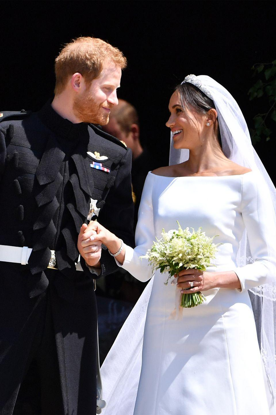 <p>Officially the Duke and Duchess of Sussex, Harry and Meghan gazed at each other as they exited St. George's Chapel in Windsor Castle after their wedding ceremony. </p>