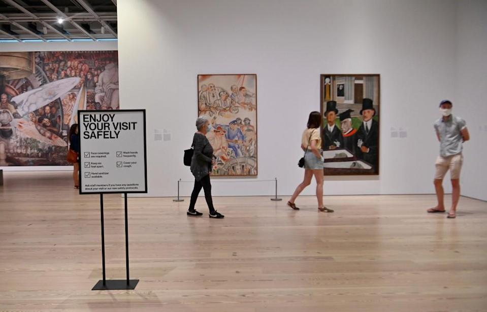 Visitors taking in an exhibition at the Whitney Museum of American Art in New York, September 3, 2020.