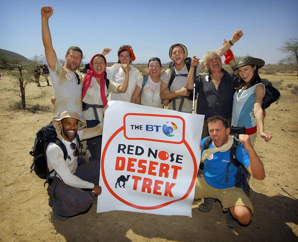 EDITORIAL USE ONLY. TO BE USED ONLY IN CONJUNCTION WITH THE STORY Handout photo issued by Comic Relief of Ronni Ancona, Craig David, Lorraine Kelly, Scott Mills, Olly Murs, Dermot O'Leary, Nadia Sawalha, Kara Tointon and Peter White as they reach the finishing line on day 5 of the BT Red Nose Desert Trek for Comic Relief in the Kaisut desert, Kenya.