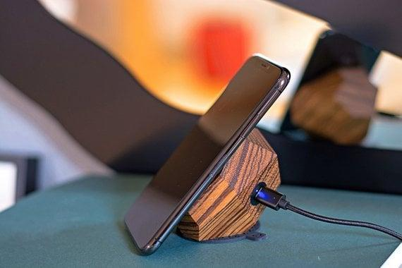 """<p>Never be on low battery again with this <a href=""""https://www.popsugar.com/buy/Halo-Fast-Charger-395385?p_name=Halo%20Fast%20Charger&retailer=etsy.com&pid=395385&price=91&evar1=news%3Aus&evar9=36026397&evar98=https%3A%2F%2Fwww.popsugar.com%2Fnews%2Fphoto-gallery%2F36026397%2Fimage%2F45606031%2FHalo-Fast-Charger&list1=gifts%2Cgadgets%2Choliday%2Cgift%20guide%2Cdigital%20life%2Ctech%20gifts%2Cgifts%20for%20men&prop13=api&pdata=1"""" class=""""link rapid-noclick-resp"""" rel=""""nofollow noopener"""" target=""""_blank"""" data-ylk=""""slk:Halo Fast Charger"""">Halo Fast Charger</a> ($91).</p>"""