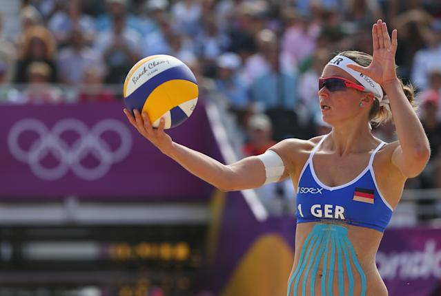 LONDON, ENGLAND - JULY 28: Katrin Holtwick of Germany serves during the Women's Beach Volleyball match between Germany and Czech Republic on Day 1 of the London 2012 Olympic Games at Horse Guards Parade on July 28, 2012 in London, England. (Photo by Alexander Hassenstein/Getty Images)