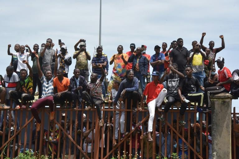 People celebrated as the coup leaders arrived at parliament for Monday's meeting (AFP/CELLOU BINANI)