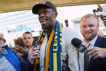 FILE PHOTO: Eight-time Olympic champion Usain Bolt reacts as he arrives at Sydney Airport ahead of his trial at the Central Coast Mariners soccer club in Australia, August 18, 2018. AAP/Erik Anderson/via REUTERS