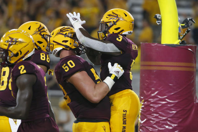 Arizona State running back Eno Benjamin (3) celebrates with teammate Jarrett Bell (50) after scoring a touchdown against Kent State during the first half of an NCAA college football game Thursday, Aug. 29, 2019, in Tempe, Ariz. (AP Photo/Ralph Freso)