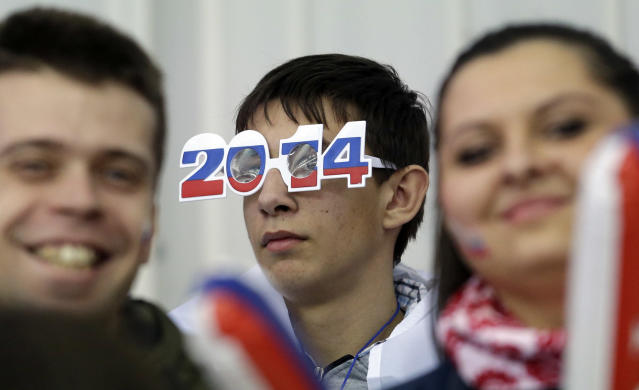 A fan watches a race during the men's 5000m event the 2014 Winter Olympics, Saturday, Feb. 8, 2014, in Sochi, Russia. (AP Photo/Morry Gash)