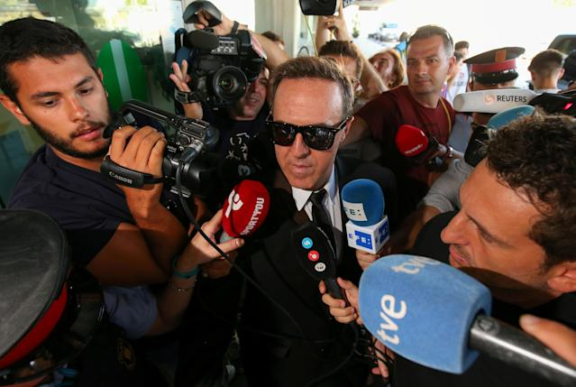 Brazilian soccer player Neymar's representative, Wagner Ribeiro, speaks to journalists at a departure terminal at the airport in Barcelona, Spain, August 4, 2017. REUTERS/Albert Gea